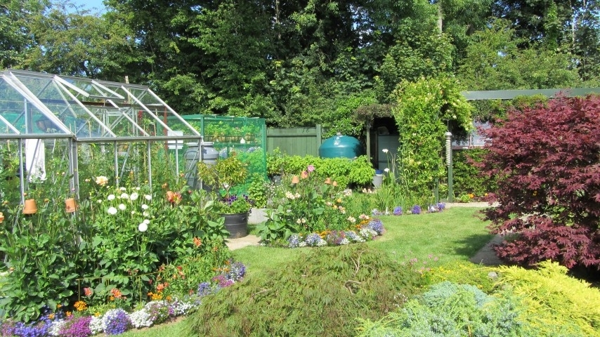 Flower Beds and greenhouse